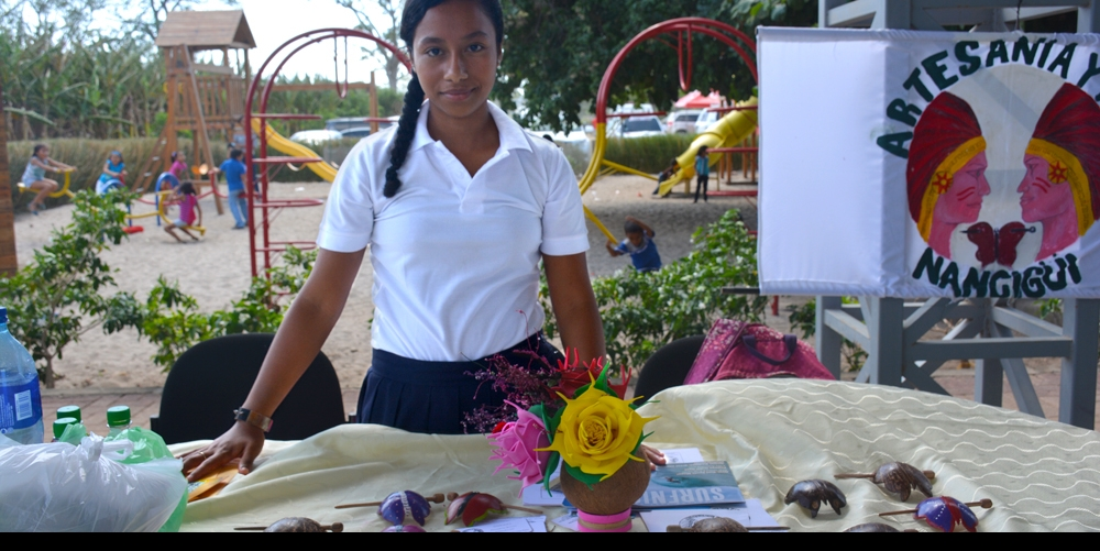 The festival was a great way for local business owners to market their products and encourage visitors and residents to buy local. Here, a young entrepreneur from the community of Nancimi presents hair accessories that she made from coconuts.